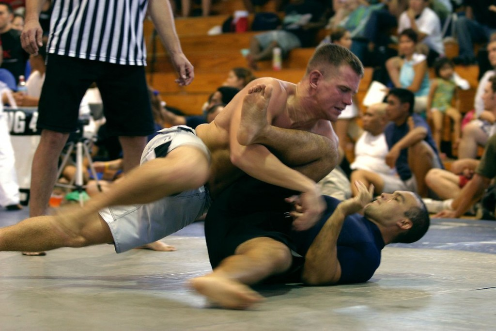 Steven Byrnes, Marine Corps Martial Arts instructor trainer, at K-Bay's Regimental Schools quickly lunges into a dominant position by moving into the side mount on his opponent during the Hawaiian State Grappling Championships.